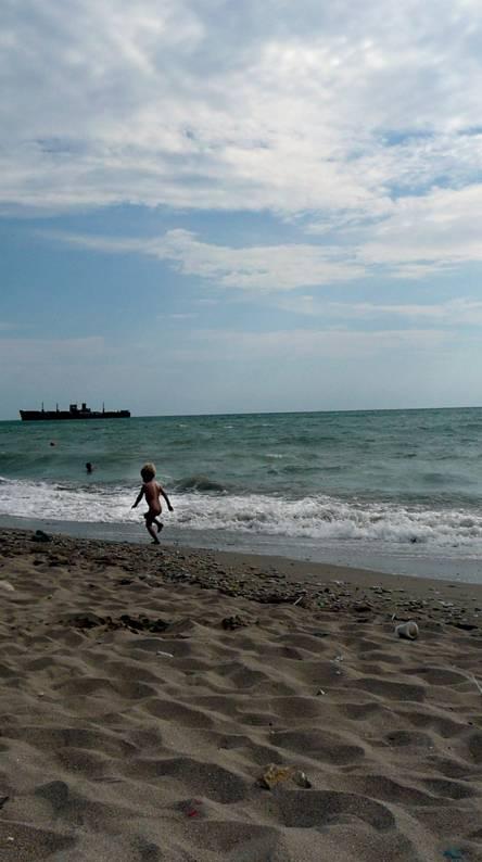 Kid On A Beach
