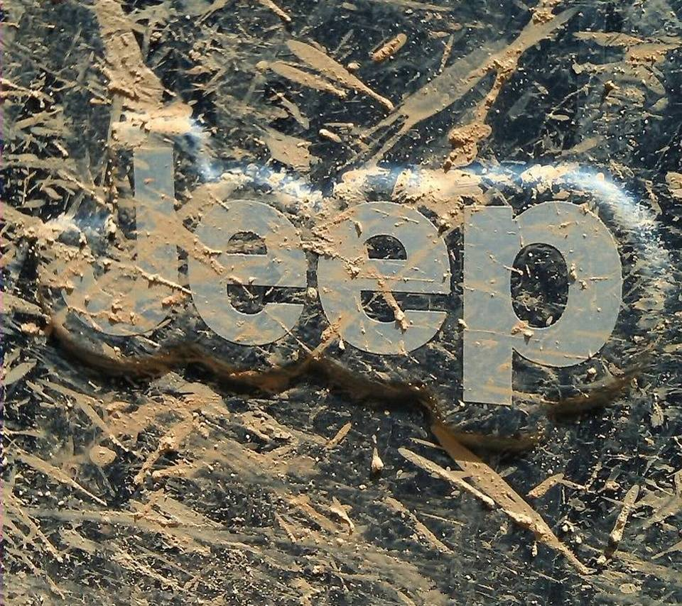 Muddy Jeep Logo