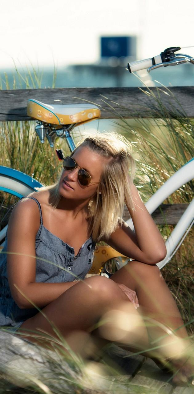Blonde in bicycle