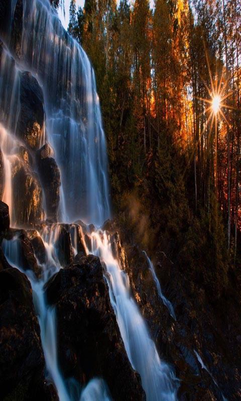 Waterfall rocks sun