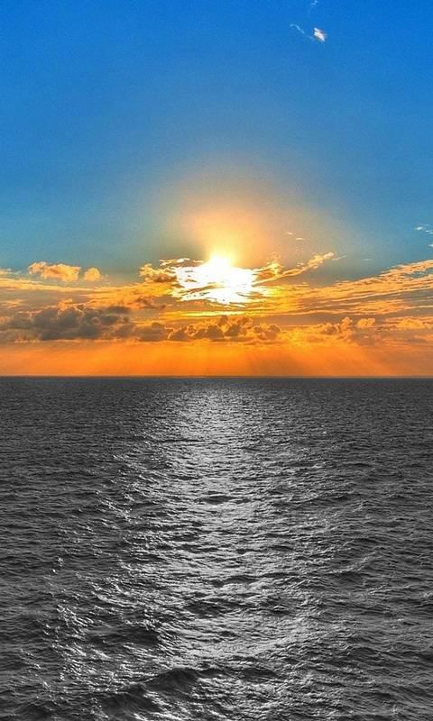 Sunset over Grey sea