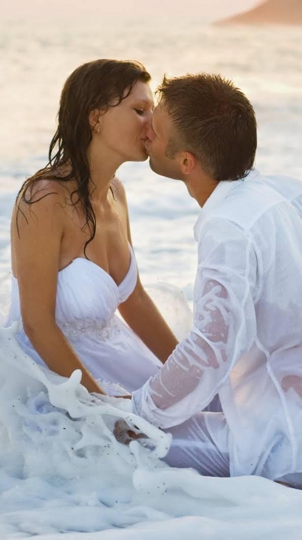 Couple Kiss In Beach