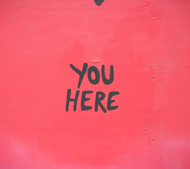 Here U